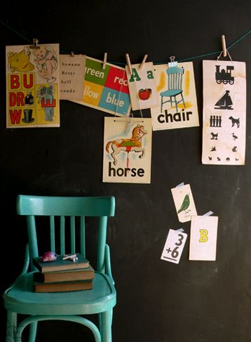 Love the idea of the chalkboard wall String across it as a great way to display posters or works of art The chair colour really pops against the black walls