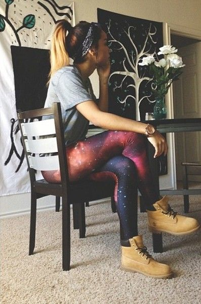Love the ponytail and headband, very vintage. Gray t-shirt-definitely shows a lot of personality matched together with the articles of this outfit. Star galaxy pants, wild, risky and genius. Tan work lace up boots complete the entire outfit.