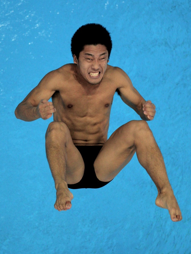 Freeze frame on Olympic divers... or just really ripped really amped people in speedos?