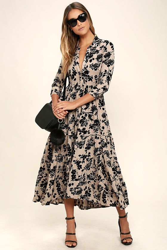 Go out and pick some wildflowers in the Amuse Society Weston Taupe Floral Print Midi Dress! An allover taupe and black floral print shapes this lightweight gauzy midi with a collared neckline, long sleeves (with button cuffs), a full button placket, and tiered midi skirt.