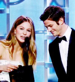 Melissa Benoist and Grant Gustin speak onstage during the 73rd Annual Golden Globe Awards  gif