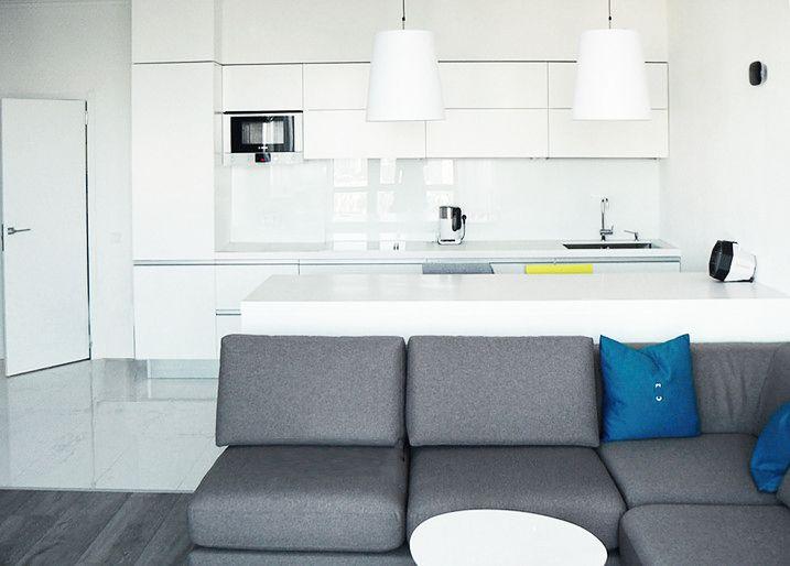 White kitchen moooi pendant studio grey sofa grey wooden floor  #SMIRNOVAINTERIORSPARIS