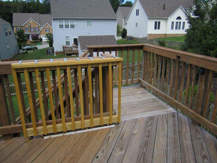 sliding deck gate   sliding on wheels diy wooden deck gate looks like here it is