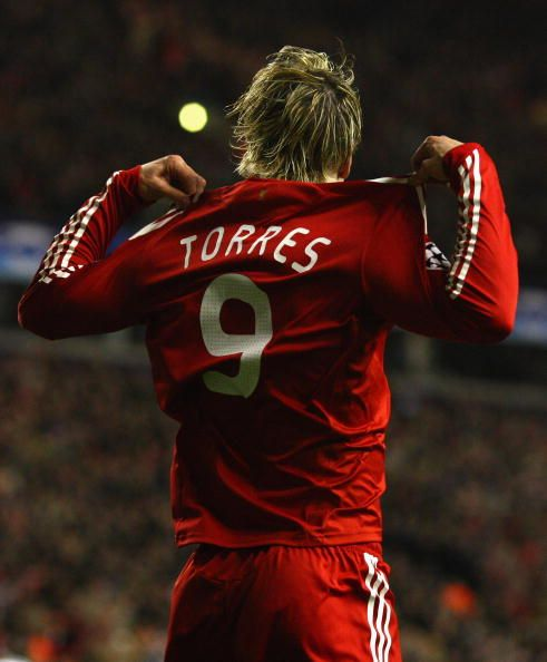 Fernando Torres of Liverpool celebrates scoring the opening goal during the UEFA Champions League Round of Sixteen Second Leg match between Liverpool...