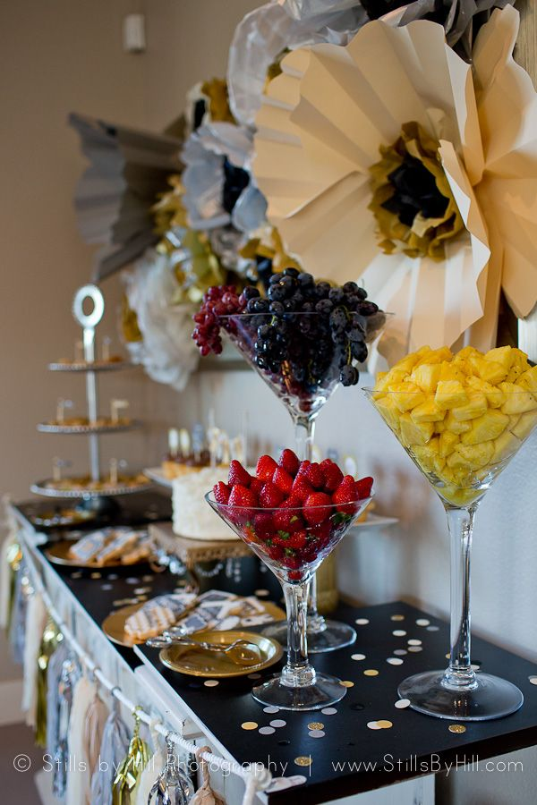 Glittery Family Milestone Celebration - fruit display in giant martini glasses on dessert table.