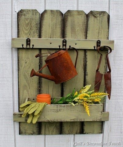 Gail's Decorative Touch: Picket Fence Organizers...Put on wall in rock garden with flowers in it...would add to the garden.  Maybe make more rustic by using large branches some how.