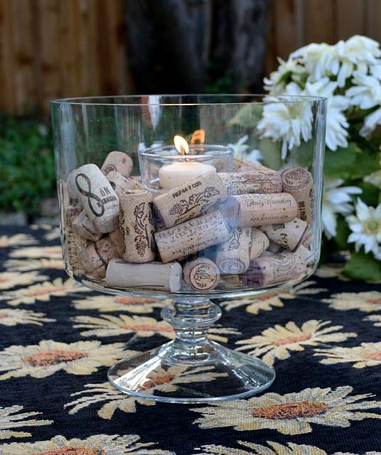 Wine corks in hurricane with candle.