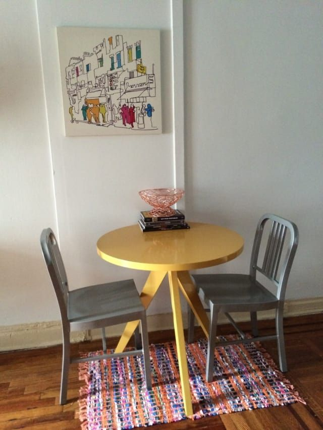 'I got the table and chairs off of Craigslist, the rose gold wire bowl on sale at Target, the rug for $6 at Century 21, the art at Ikea, and the books are all from the BuzzFeed library! My favorite color is yellow, and I love that this feels like a bright, cheery place to sit down and enjoy a meal or chat.'