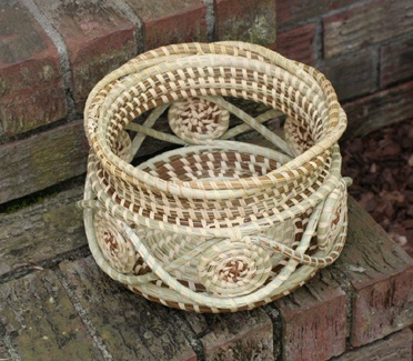 """Sweetgrass unique style bowl with the """"starter"""" of the basket on the outside."""