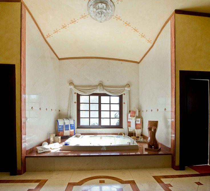 Tuscan style bathroom.  http://costaricamilliondollarhomes.com/Casa-Italian-Style-Residence/index.html