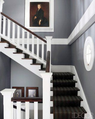 Henri Le Menestrel of the French design resource Le Cèdre Rouge devised a neoclassical, New England–style home in the town of Saint-Cloud on the outskirts of Paris. Painted in Farrow & Ball's Down Pipe gray and decorated with a striped runner, the stairwell doubles as a witty portrait gallery of humans and canines.