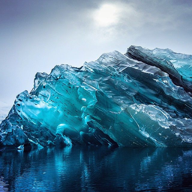 Photos of an Upside Down Iceberg by Alex Cornell. During a recent trip to Antarctica, designer and filmmaker Alex Cornell came across a breathtakingly beautiful iceberg that, unlike its icy neighbors, had a gem-like translucence and a striking aquamarine color. The unusual iceberg was an example of a rarely photographed phenomena–an iceberg that has recently inverted, revealing its normally hidden semi-translucent underside.