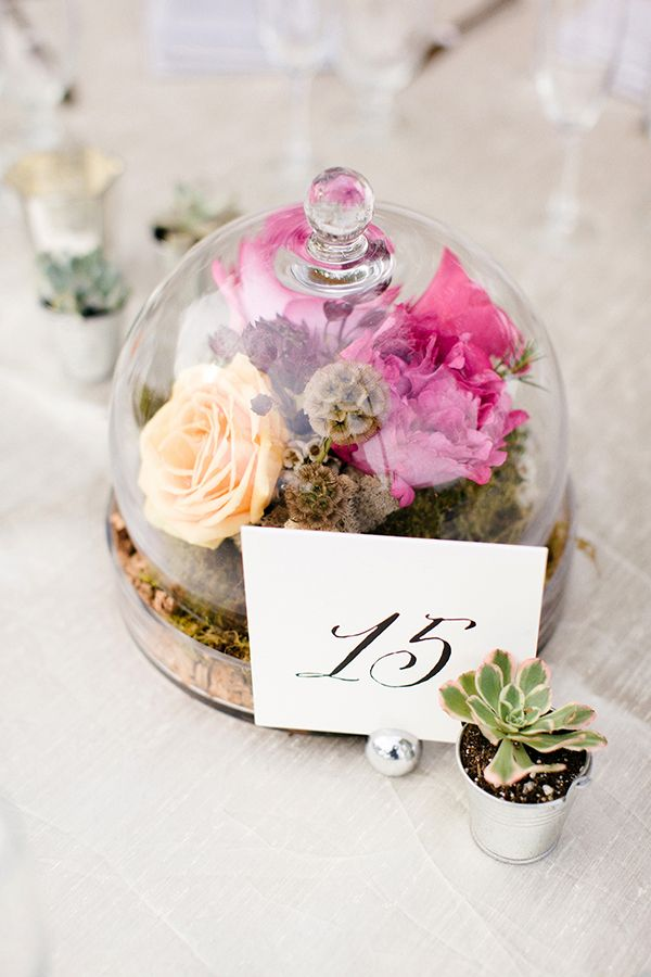 pretty domed jar centerpiece for unusual floral table decorations.