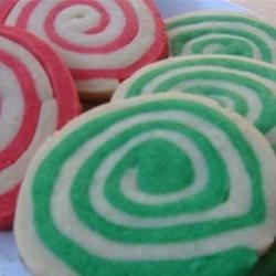 Sheets of red and green butter cookie dough are rolled around each other to make a log of spiraling colors. Sliced into colorful pinwheels, these heirloom cookies are the perfect holiday treat. They can also be made in a chocolate-vanilla pinwheel variation.