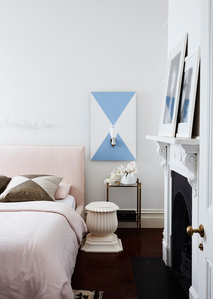 A velvet bedhead in millennial pink creates a calming and luxurious bedroom to unwind in. Story: Belle