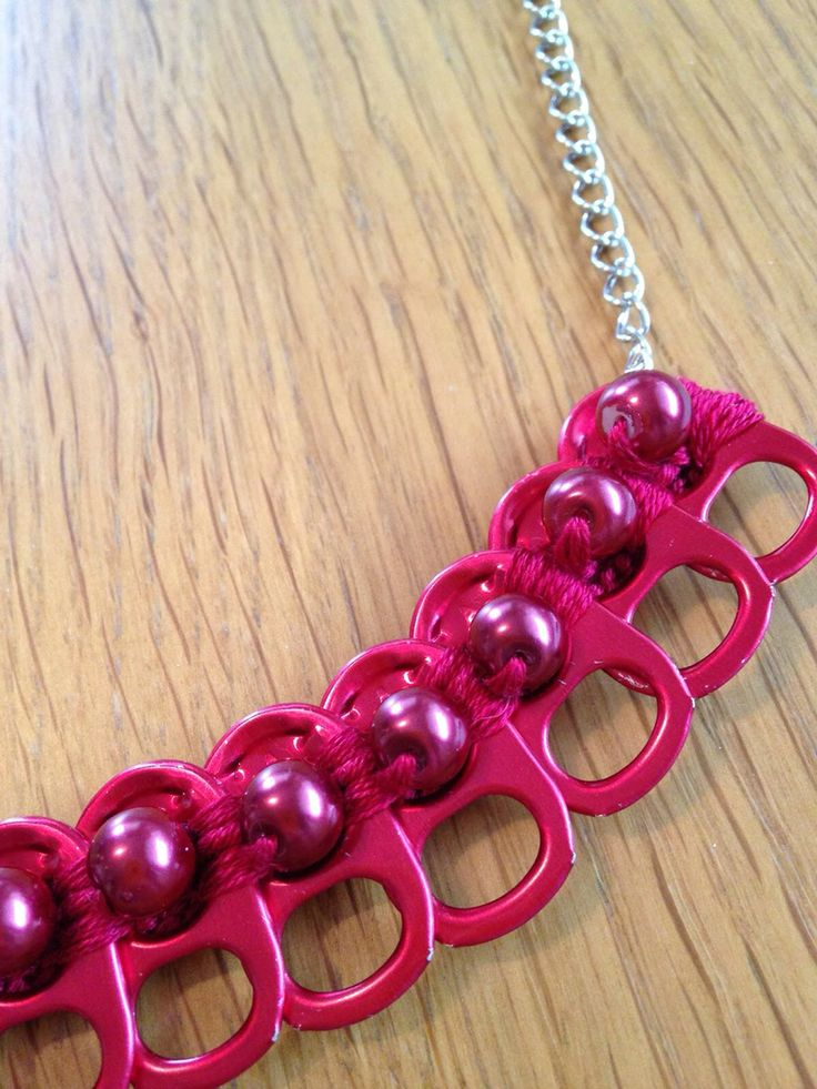 Necklace made with red soda tabs