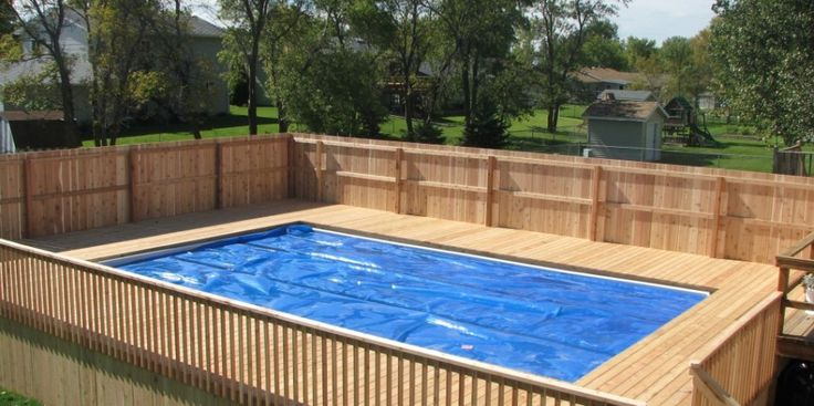 Awesome above ground pool deck railing with wooden deck for Above ground pool siding ideas