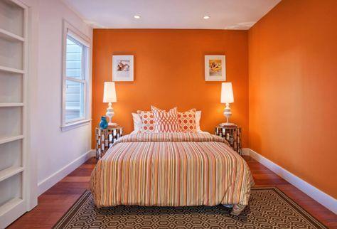 Dormitorio joven naranja en dos paredes