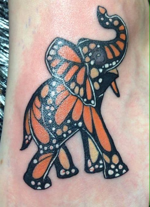 Monarch Butterfly Tattoo. This is so cute and creative. Although I wouldn't personally get it tattooed I absolutely love it