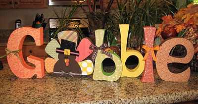 Decorate some wood letters to make great holiday decor. I love how the O is a turkey!