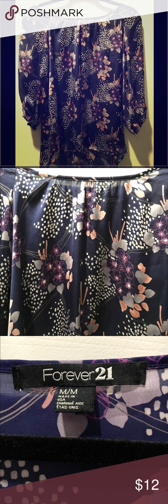 Forever 21 Flower Flowing Blouse w/ slits in arms Forever 21 Flower Flowing Blouse w/ slits in arms - color is purple - silky material - size medium - super cute and in great condition! Forever 21 Tops Blouses