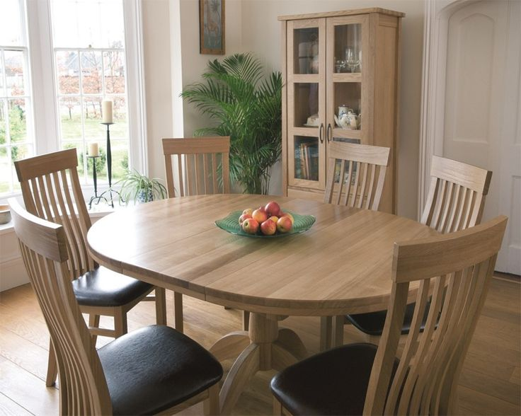 The TCH Windsor Single Extending Pedestal Dining Table is hand made in Lithuania using only the finest quality European Solid Oak.