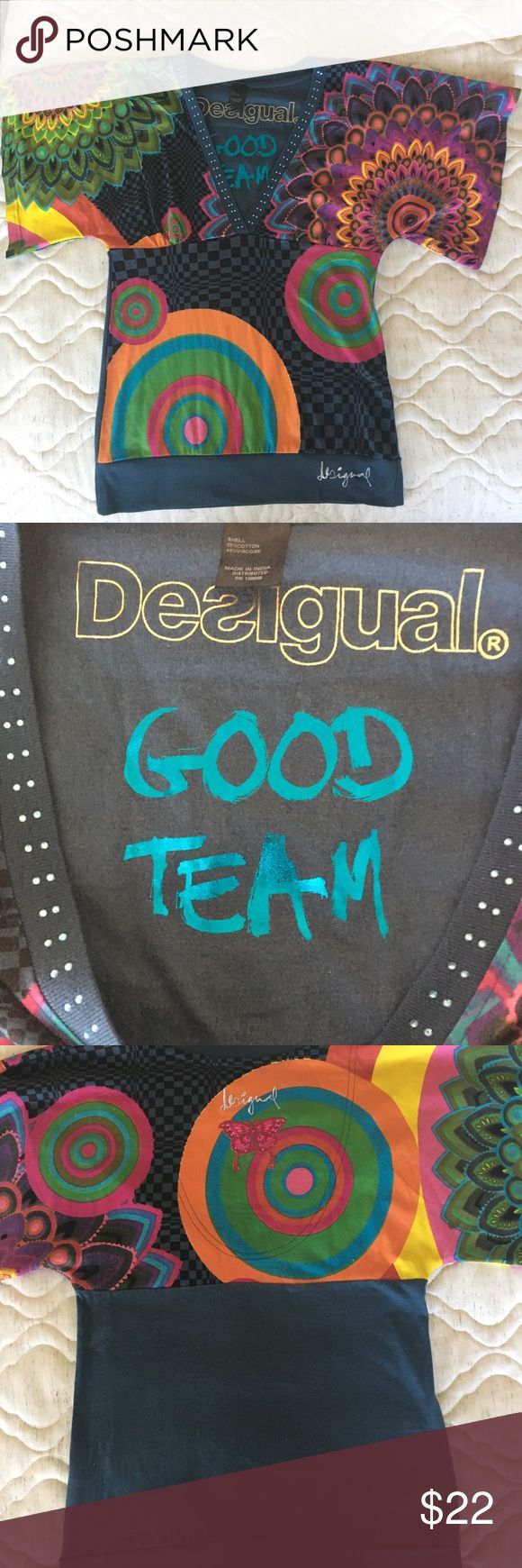 Desigual V neck top Totally cute Desigual top. Size Small in US. Measures 18 inches on the bottom. Cotton blend. EUC. Smoke and pet free home. Desigual Tops Tees - Short Sleeve