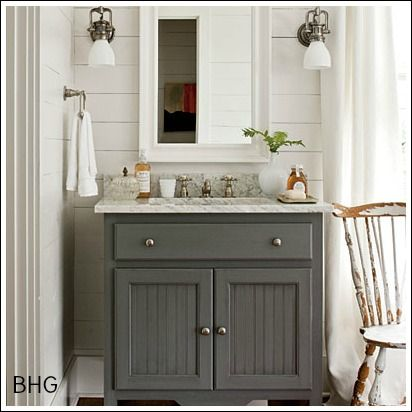 Perfect gray color lavatory vanity, silver/pewter hardware (see spray paint pin, it's on there), white framed mirror, big sconces, marble top. Stripes on doors for mine? LOOK!