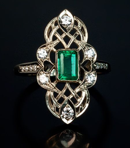 A Vintage Art Deco Emerald and Diamond Ring, Circa 1930. A 14K white gold openwork milgrain ring is set with an emerald-cut emerald, six brilliant diamonds and eight single-cut diamonds.