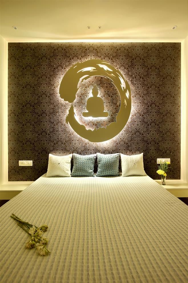 The back wall in the children's bedroom creates an aura of spirituality.The  Gautam Buddha