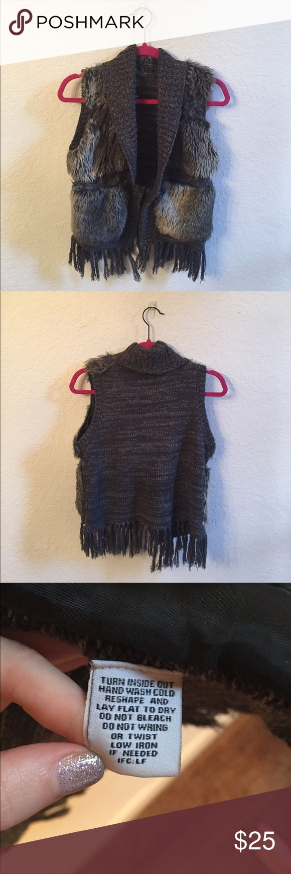 Fur vest Gray with fringe crochet/knit Fur vest with fringe Gray!! Super cute!! Only tag is shown. Perfect for Fall and winter to pair with jeans or a long sleeve undershirt. Fringe adds a fun accent. :) Jackets & Coats Vests