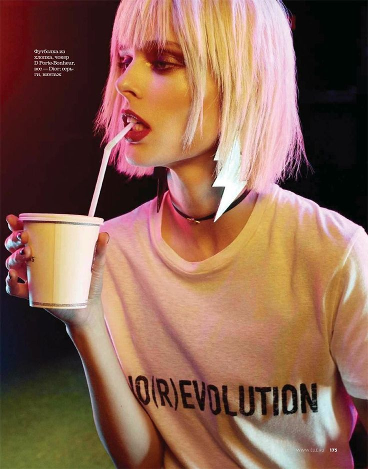Wearing a blunt platinum blonde bob, Coco Rocha poses in Dior t-shirt