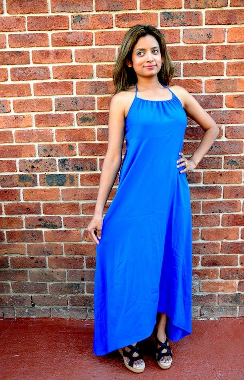 This dress ticks all the boxes. Halter neck, Hi low hem line, pretty blue and soft crepe fabric. Dress it up or dress it down, its up to you! Available in S,M,L,XL & XXL from www.axori.com.au