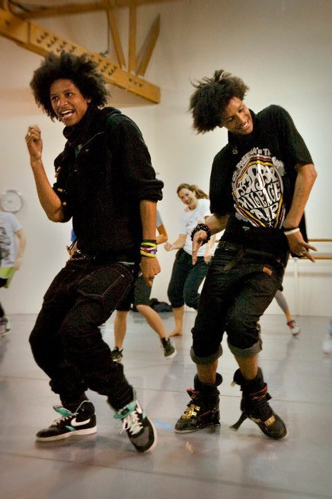 Les twins . Dance is a form of art the way a person paints the room with their movements the way the crowd reacts we're somewhat the paintbrush and the Audience is the canvas