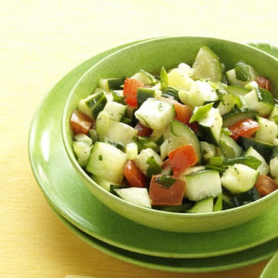 Minted Cucumber Salad includes mint,tomatoes, cucumbers, parsley.