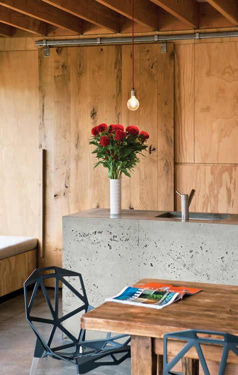 kitchen with concrete benchtop and wood cabinets