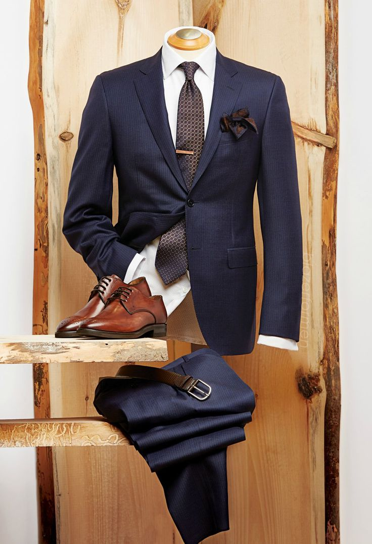 The Instigator Canali shadow stripe suit - Italy Duchamp twill dot french cuff shirt - Portugal Canali silk tie - Italy Eton silk knit pocket square - Italy Liel & Lentz wood tie bar - Toronto Canali embossed belt - Italy Giulio Moretti burnished brogue shoes - Italy