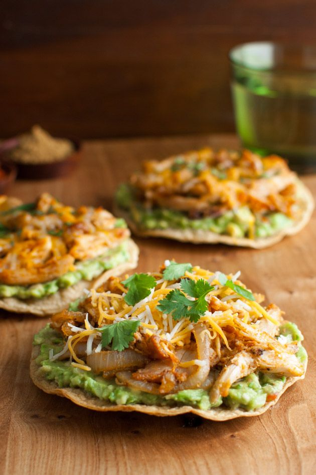Easy and healthy tostadas using baked corn tortillas and rotisserie chicken spiced with cumin and paprika from tamingofthespoon.com