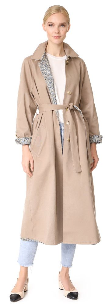 reversible trench coat by Robert Rodriguez. A reversible Robert Rodriguez trench coat with a neutral twill side and a printed silk side. The pared-down structure...