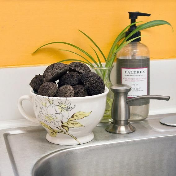 These handy sink cleaners repurpose your used coffee grounds, plus cost next-to-nothing to DIY. Along with making your garbage disposal smell like a fresh cup o'joe, the grains will also sharpen your disposal's blades. A total win-win! Get the simple instructions here. (Credit: Popsugar)