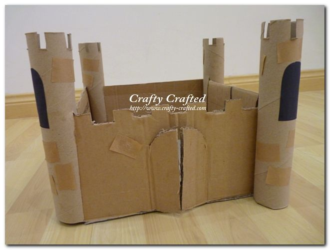 Castle out of cardboard scraps and paper towel rolls.