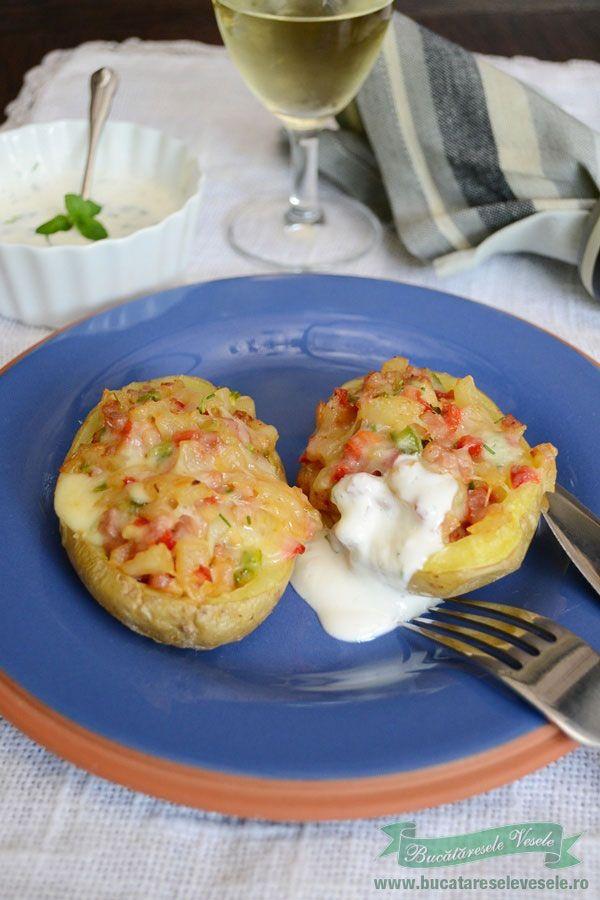 Cartofi umpluti cu sunca si cascaval afumat reteta culinara.Ingrediente cartofi umpluti cu sunca si cascaval afumat. Cum se fac cartofii umpluti cu cascaval.