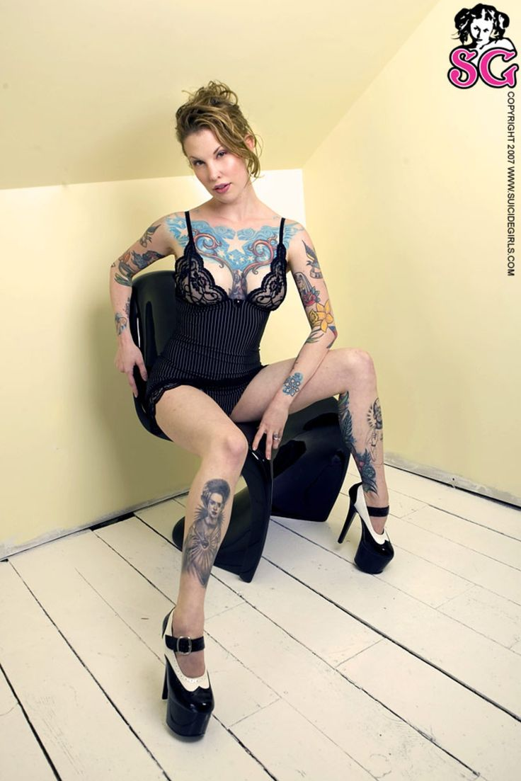 Twwly Suicide put on a teddy and heels to show off her bad ass tattoo artwork http://suicidegirls.com/join