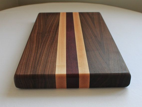 "This cutting board is built to last. It is made with Walnut, Maple and Purpleheart and its measurements are 17 1/"" W x 11"" H x 1 1/2"" thick."