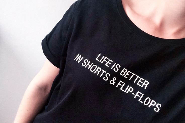 """Black t-shirt with quote: """"life is better in shorts & flip-flops"""""""