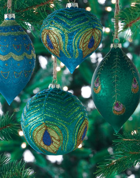 Feather your tree with peacock feather ornaments. #holiday2012 HomeDecorators.com: