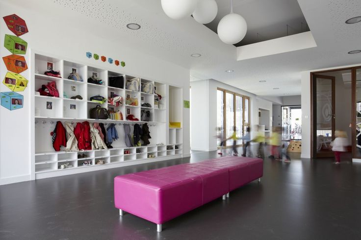 The House of the Early Childhood / TOPOS ARCHITECTURE, daycare, cubby, coat hook, acoustical gyp, wood relites, wood windows, pink furniture bench