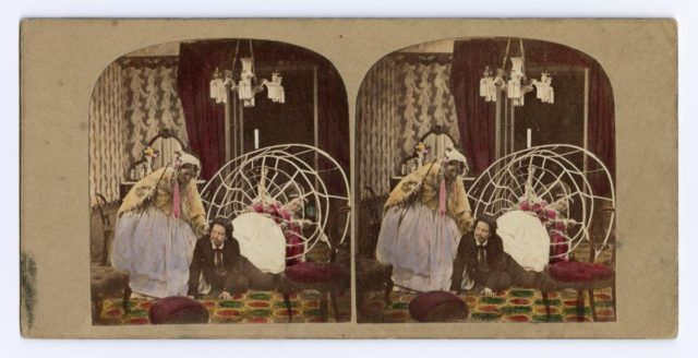 Stereocard depicting a man discovered under a ladies crinoline, by an unknown photographer.