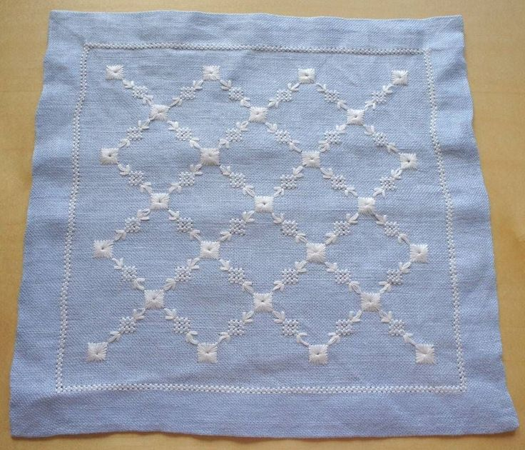 Swedish hand-embroidered light blue linen doily with white star/leaves pattern