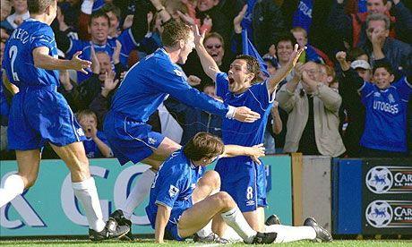 Gus Poyet celebrates a goal at the Bridge as Chelsea thrash Manchester United 5-0 in 1999